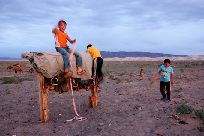 The 3 sons of our host family at the Dunes helped to mount up the camels for our journey.