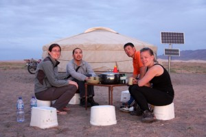 At the ger camp near the Singing Sand Dunes in the Gobi Desert. From left to right: Laurie, Dave from Australia, the father of the Mongolian family hosting us that night, and Sofie from Sweden.