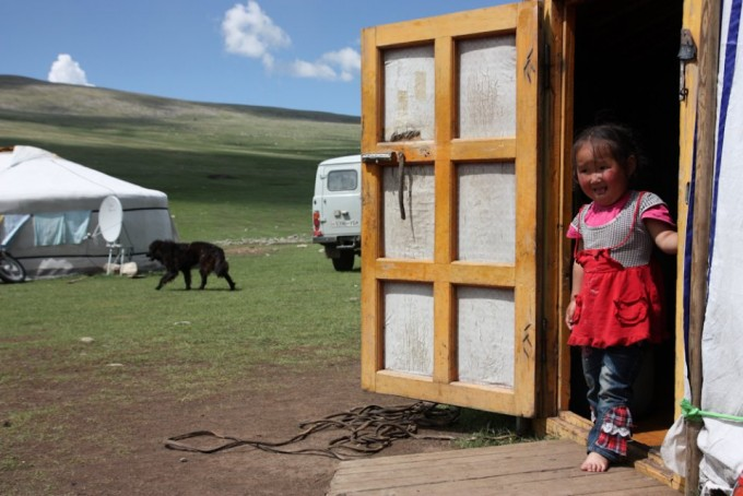 A Mongolian family living in the steppes, a region of rolling hills covered in lush grass which makes up the northern part of Mongolia.