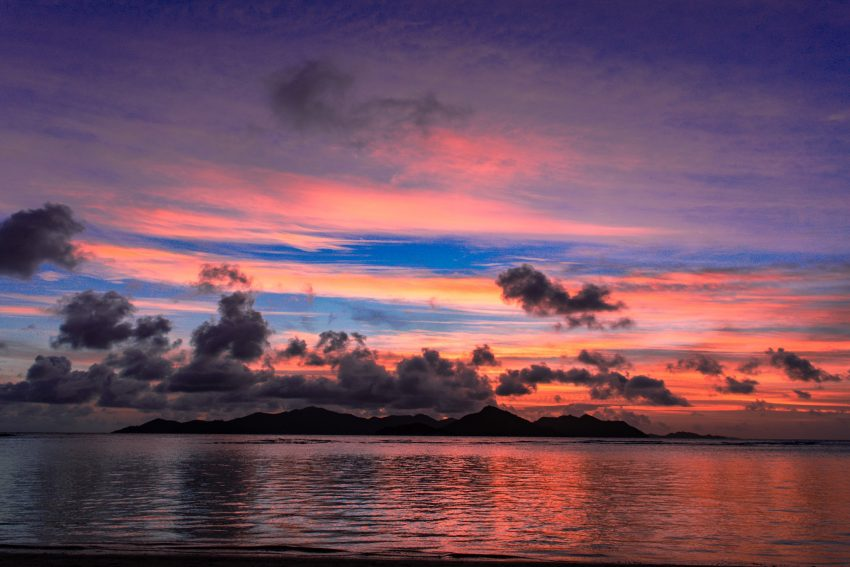 Sunset at Anse La Reunion How to Visit the Seychelles for 2 Weeks for Under $730 USD