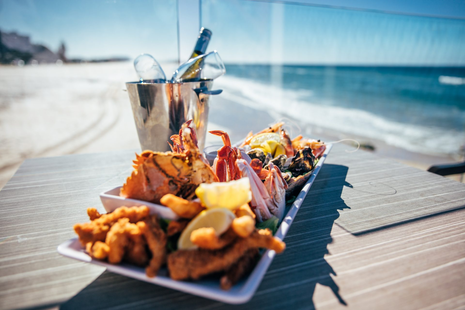 Currumbin beachside cafe plate of seafood and wine