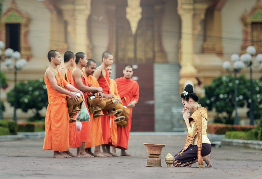 Monks during Tak Bak morning alms in laos