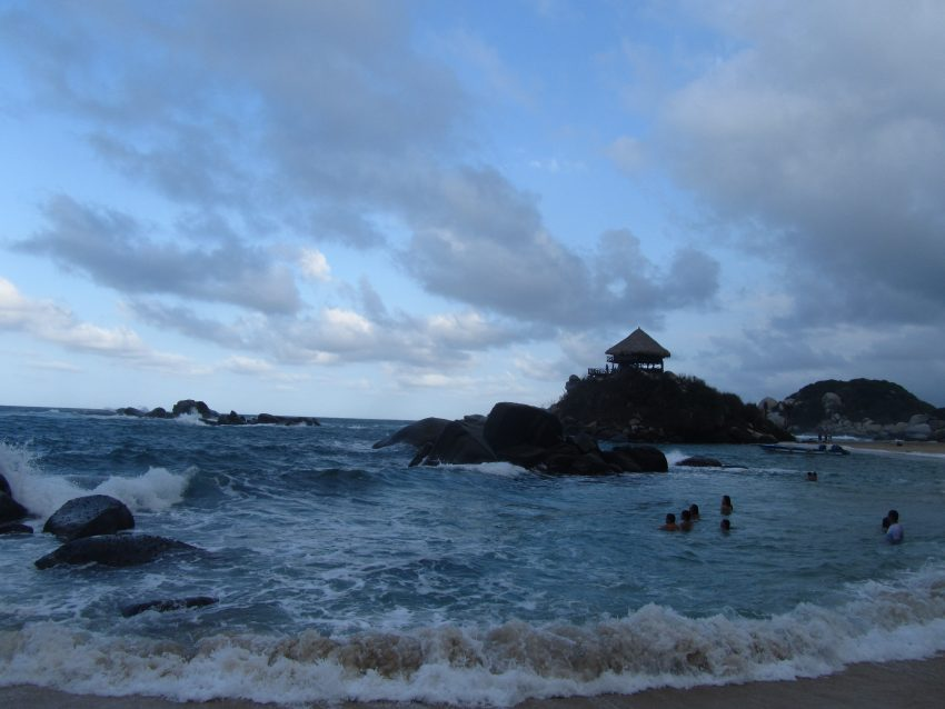 The beach at Cabo San Juan with the rock where the hammocks are in the background Tayrona National Park – A Great Weekend Escape from Cartagena